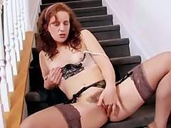 Redheaded milf Helena masturbating in thigh high stockings and panties