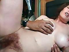 Horny milf enjoys hard cock deep into her hairy pussy